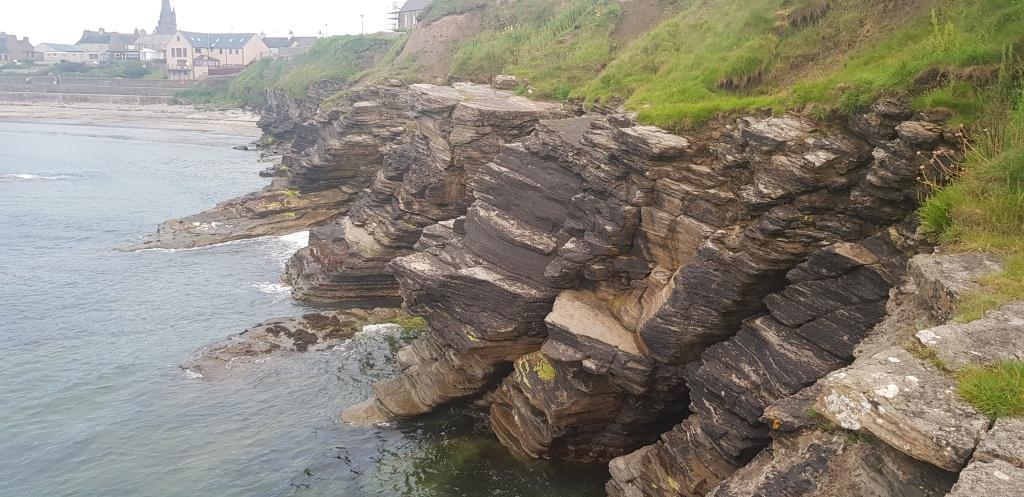 Thurso cliff edges, Thurso in the background.